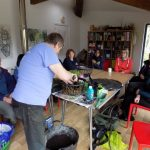 Volunteers learn to make hanging baskets