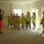 Contractor Kenneth MacDonald of S&K MacDonald Homes shows pupils round the (nearly completed) school