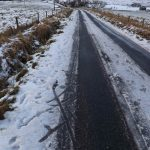 Image shows the tracks of prams/pushchairs having to draw off the road to avoid traffic. Deep ditches either side