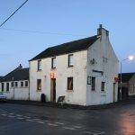 The dilapidated Swan Inn prior to renovations